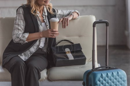woman with suitcase and coffee