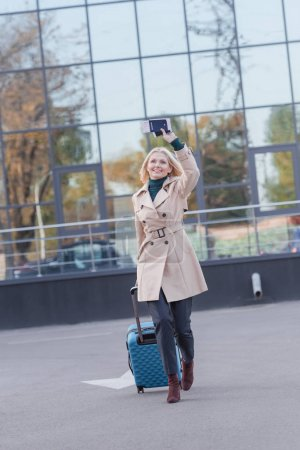 woman with flight ticket waving hand