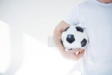young man with soccer ball