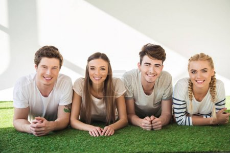 Photo for Happy young friends lying together and smiling at camera - Royalty Free Image