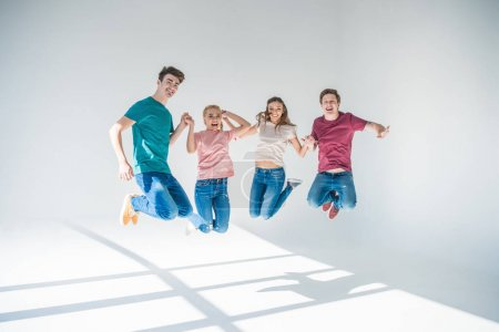 young friends jumping together
