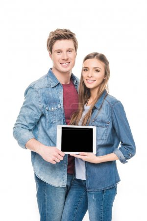 Photo for Smiling young couple holding digital tablet with blank screen isolated on white - Royalty Free Image