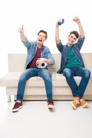 friends with soccer ball on sofa