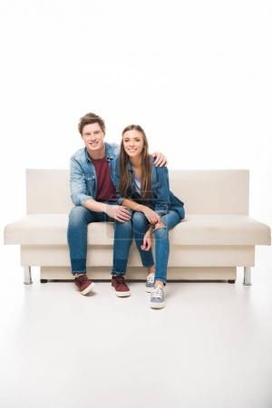 young couple sitting on sofa