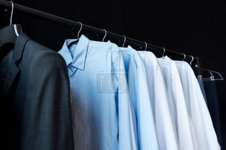 Photo for Close-up view of stylish male shirts on hangers in boutique - Royalty Free Image