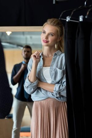 couple choosing necktie in boutique