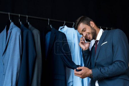 businessman talking on smartphone in boutique