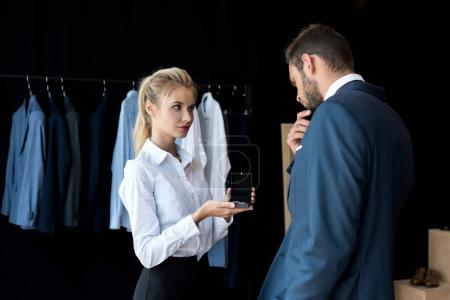 Businessman and seller in boutique