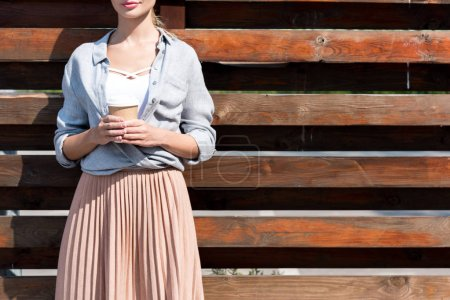 young woman with coffee to go