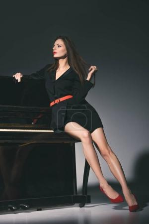 woman posing on piano