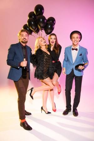 friends with champagne and black balloons