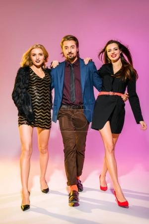 stylish man with two girlfriends