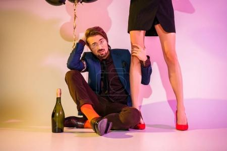 couple with champagne and balloons