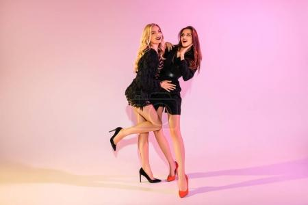 Photo for Young cheerful glamorous girls posing on pink - Royalty Free Image