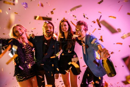 excited friends on party with confetti