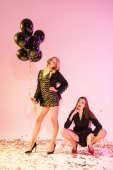 glamorous girls with black balloons