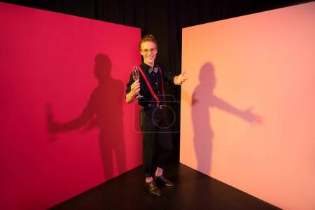 Photo for Young glamorous man drinking champagne in studio - Royalty Free Image