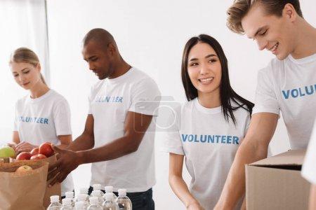multiethnic volunteers working together