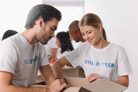 volunteers packing goods in box
