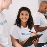 Group of young multiethnic volunteers working toge...