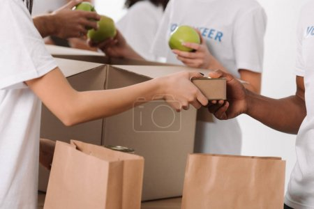 volunteers packing food for charity