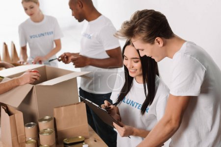Photo for High angle view of volunteers working together - Royalty Free Image