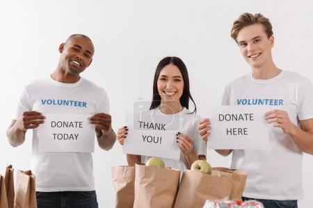 volunteers holding charity placards