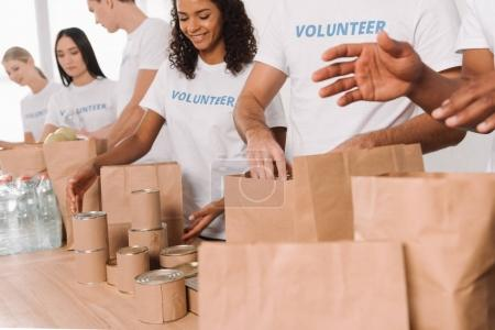volunteers putting food and drinks into bags