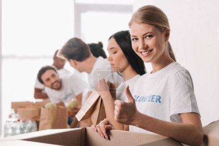 volunteer showing thumb up
