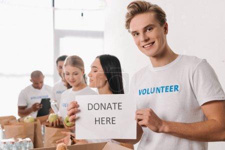 volunteer holding charity placard