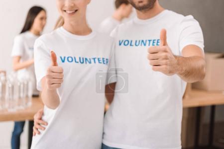 volunteers showing thumb up