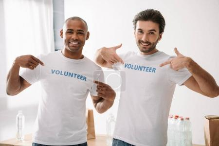 volunteers pointing at signs on t-shirts