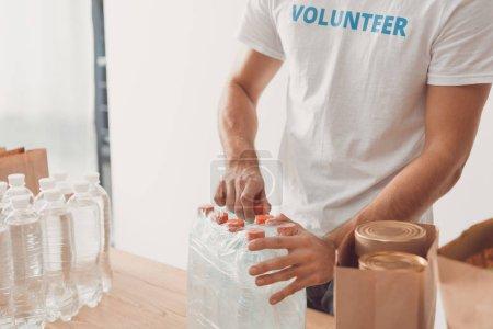 volunteer opening pack of water bottles