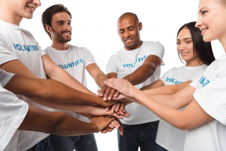 volunteers making team gesture