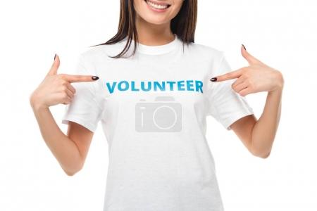 Photo for Cropped shot of female volunteer pointing at sign on t-shirt isolated on white - Royalty Free Image