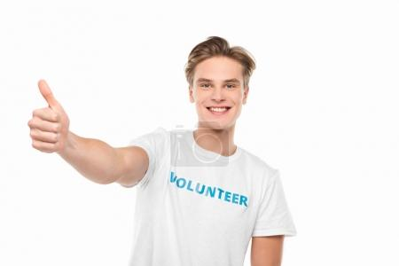 Photo for Young volunteer showing thumb up isolated on white - Royalty Free Image