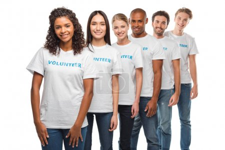 Photo for Happy multiethnic group of volunteers standing in row and looking at camera isolated on white - Royalty Free Image