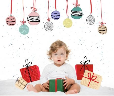 toddler girl with wrapped present
