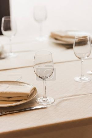 Served table with wineglasses and plates