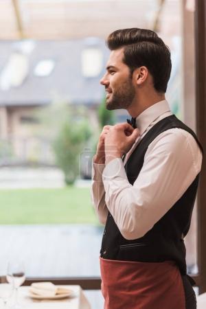 waiter fixing bow tie