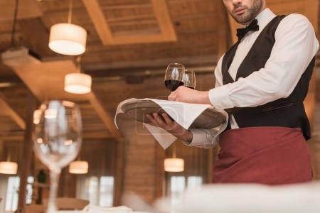 Photo for Cropped image of waiter holding tray with wineglasses - Royalty Free Image