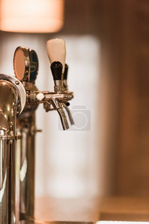 Beer taps at bar counter