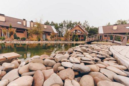 Stones at pond shore