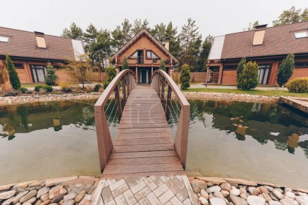 Wooden bridge over pond