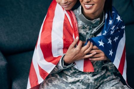 family wrapped with american flag