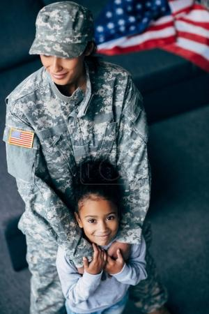 daughter and mother in military uniform