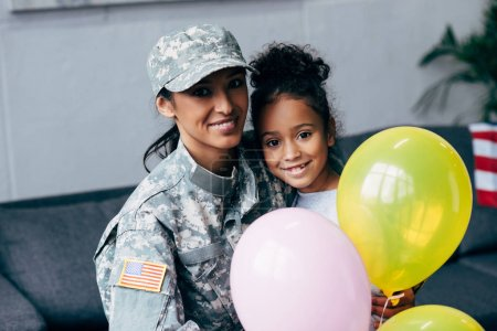 daughter mother in military uniform with balloons