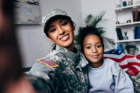 daughter and soldier taking selfie