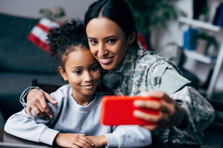 soldier taking selfie with daughter