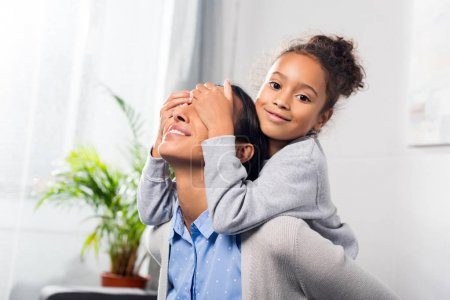 daughter closing eyes of mother